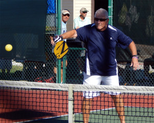 Man backhands ball in Mens Doubles Pickleball Tournament Tampa Bay Senior Games 2013, Sun City Center