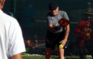 Man hits ball in Pickleball Tournament atTampa Bay Senior Games 2013, Sun City Center, Florida [DAY ONE: Friday, October 25, 2013]