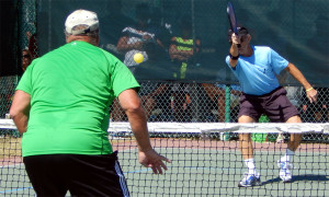 Man hitting ball in Mixed Doubles in Pickleball Tournament 2013 Tampa Bay Senior Games, Sun City Center