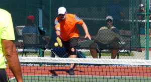 Man serves in Men's Doubles Pickleball Tournament ages 50 - 54 at Tampa Bay Senior Games, Sun City Center, FL [DAY TWO: Saturday, October 26, 2013]