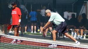 Man serving in Mens Doubles Pickleball Tournament Tampa Bay Senior Games 2013, Sun City Center