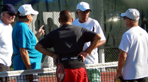 Men talking on court before game at Mens Doubles Pickleball Tournament Tampa Bay Senior Games 2013, Sun City Center