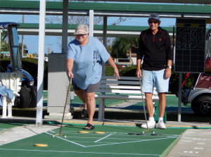 Mixed team playing Shuffleboard in Kings Point, Sun City Center, FL
