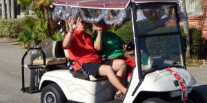 NOEL ribbon with silver tensile on golf cart in Sun City Center Holiday Golf Cart Parade 2013