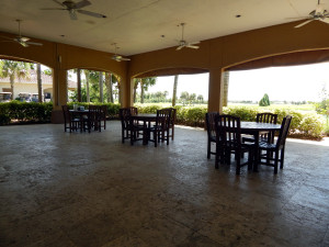 Outside dining area with roof and ceiling fans at the South Club House in Kings Point, Sun City Center, FL