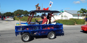 PALM GARDENS blue fringe golf cart in Sun City Center Holiday Golf Cart Parade 2013