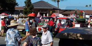 PARADE ends while people gather at the band stand at the Sun City Center Holiday Golf Cart Parade 2013