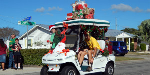 PRESENTS on roof of golf cart in Sun City Center 2013 Golf Cart Parade