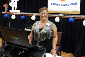 Patricia Hagan (Cuer) playing digital music from laptop at 45th Anniversary of SCC Swingers Square Dance Club, Community Hall