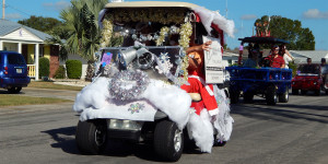 Paula Allen from Gulf Coast Insurance Group in winning cart at Sun City Center Holiday Golf Cart Parade 2013