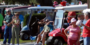 People watching 2013 Golf Cart Parade come to a close at Sun City Center