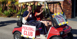 Pickleball club golf cart in Sun City Center Holiday Golf Cart Parade 2013