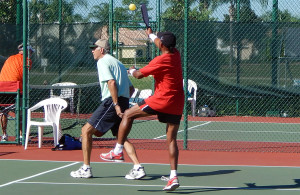Player getting ready to hit ball at Pickleball 70 Plus Doubles tournament at Tampa Bay Senior Games 2013, Sun City Center, Florida [DAY ONE: Friday, October 25, 2013]