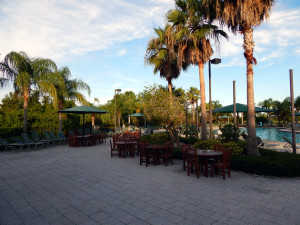 Tables on the deck of the outdoor pool at Kings Point South Club House, Sun City Center, Florida