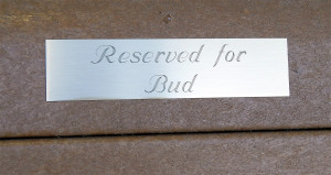 RESERVED FOR BUD gold plaque on bench at Winn Dixie, Sun City Center, FL