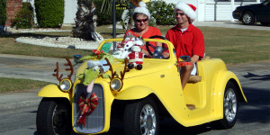 Scott McFarland and Glenna McFarland in ROADSTER with antlers on headlights at Sun City Center Golf Cart Holiday Parade 2013