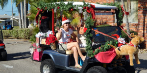 Reindeer pulling golf cart decoration in Sun City Center Holiday Golf Cart Parade 2013