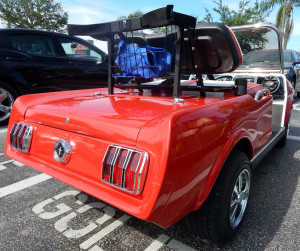 Rear view of red 1965 Ford Mustang customized golf cart at Walgreens in Sun City Center, Florida