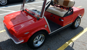 Red 1965 Mustang Club Car golf cart in Sun City Center, FL