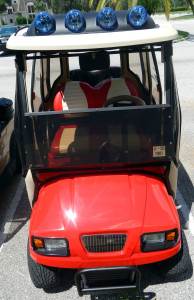 Red Ford Truck Club Car golf cart with off the road light bar in Sun City Center, Fl