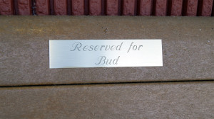 Reserved for BUD plate on bench at Winn Dixie Grocery store in Sun City Center