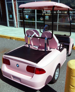Right rear view of Pink Mar Kay BMW Club Car golf cart at Dollar Tree in Sun City Center, FL