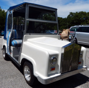 Rolls Royce golf cart with round headlights and chrome grille at Winn Dixie in Sun City Center, Florida