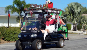 SANTA SLEIGH on roof of HDK golf cart in Sun City Center Holiday Golf Cart Parade 2013