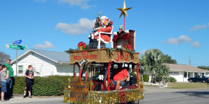 SCC WOODCARVERS in golf cart in Sun City Center Holiday Golf Cart Parade 2013