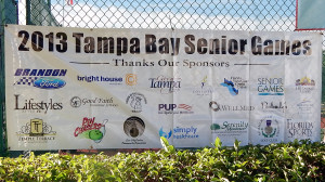 SIGN Tampa Bay Senior Games 2013 Sponsors hanging on fence of Pickleball Court, Sun City Center