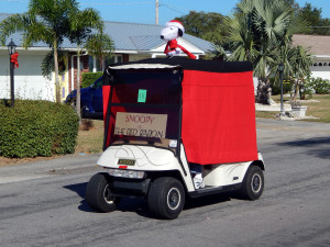 SNOOPY customized Christmas golf cart in Sun City Center Holiday Golf Cart Parade 2013