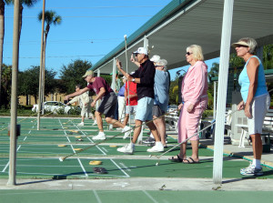 Showing points by holding up fingers in shuffleboard game in Kings Point, Sun City Center, FL