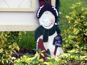 Snowman holding Let It Snow sign on Nantucket Association entrance in Sun City Center, Florida