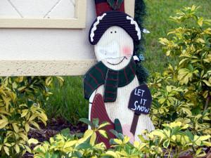 Snowman holding Let It Snow sign on Nantucket Association entrance in Sun City Center, Florida
