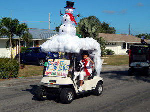 Snowman on top of golf cart in Sun City Center Holiday Golf Cart Parade 2013