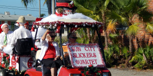 Sun City Center Slickers Quartet pulled by cart in Sun City Center Holiday Golf Cart Parade 2013
