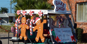 The Bake Shop with giant cookies men on cart at Sun City Center Holiday Golf Cart Parade 2013