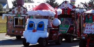 Three long lines golf carts getting ready to start at Sun City Center Holiday Golf Cart Parade 2013