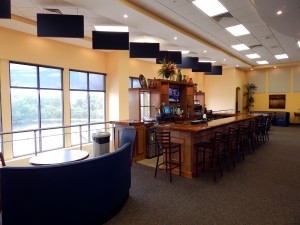 Upstairs Bar with windows that span length of bar at Kings Point South Club 1