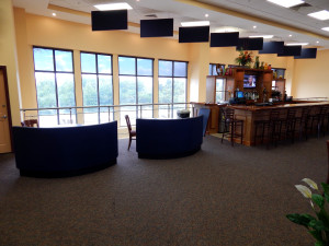Upstairs Bar with windows that span length of bar at Kings Point South Club