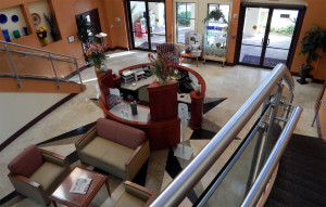 Walking down the steps from the 2nd floor breakfast bar at the Kings Point South Clubhouse, Sun City Center, Florida