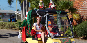 Weavers Club golf cart with Snowmen on roof in Sun City Center Holiday Golf Cart Parade 2013