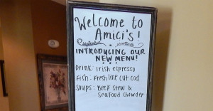 Welcom to Amici's sign with specials at Club Renaissance in Sun City Center, FL