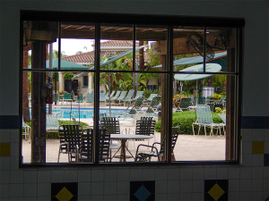 Standing inside next to the indoor pool, you can see the outdoor pool from the windows