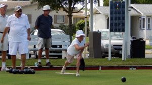 Woman Lawn Bowler by Eberhardt Building on North Pebble Beach Blvd in Sun City Center, FL