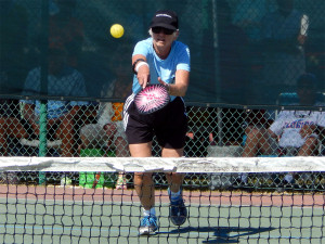 Woman action shot in Mixed Doubles in Pickleball Tournament 2013 Tampa Bay Senior Games, Sun City Center