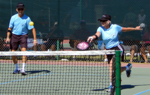 Woman hitting ball in Mixed Doubles in Pickleball Tournament 2013 Tampa Bay Senior Games, Sun City Center