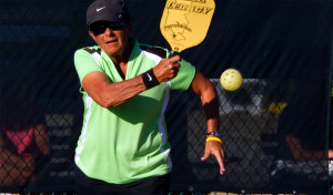Women hitting ball in Womens Doubles Pickleball Tournament Tampa Bay Senior Games 2013 Sun City Center
