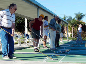 men and women playing shuffleboard in Kings Point, Sun City Center, FL