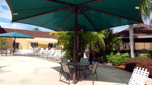 Main Clubhouse Pool in Kings Point with umbrella shading table